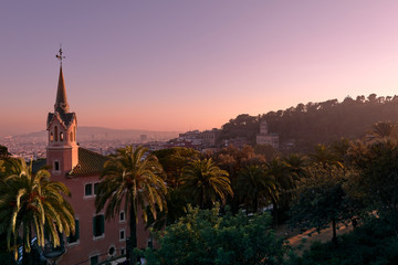 Beautiful high angle view of the Barcelona from Park Guell during pink vanilla sunset