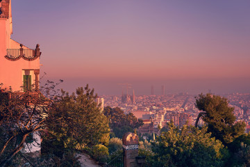 Beautiful panoramic view of the Barcelona with Sagrada Familia construction from Park Guell during sunset with pink sky