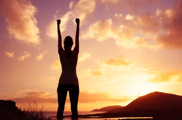 Get out get fit! Confident woman with fist in the air celebrating.