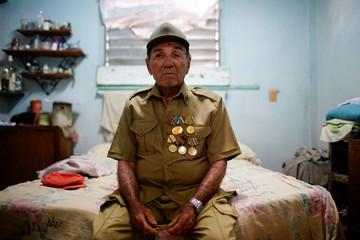 Former rebel Nelson Alvarez, 85, poses for a photo in his home in El Cobre