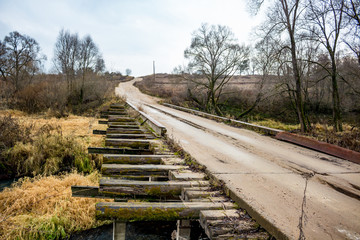 Automobile bridge in the countryside across the river