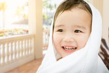 Happy Cute Mixed Race Chinese and Caucasian Boy On Tropical Patio Wrapped In A Towel