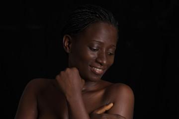 beautiful smiling woman shirtless on black background