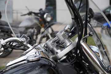 Motorcycles. Close Up of steering wheel and windshield.
