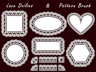 Pattern lace brush and openwork white napkin isolated on a dark background.