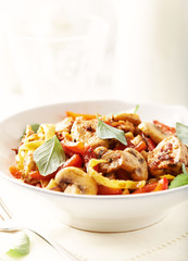 Tagliatelle pasta with chicken mushrooms, red pepper and onion.