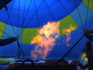 The fire rising the inside of a hot air balloon.