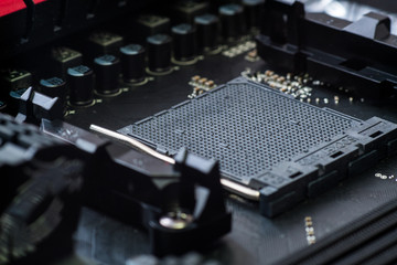 CPU socket and processor on the motherboard. Focus on the motherboard. Toned image