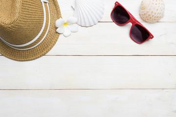 summer beach accessories on wood