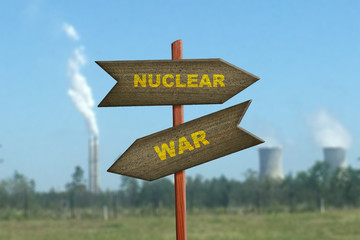 Nuclear War sign on factory plant background