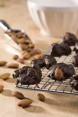Close-up of dark chocolate almond clusters on cooling rack