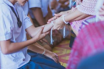 Handfasting. Selective focus on hands of Thai graduation ceremon