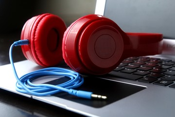 Stereo headphones and a laptop computer