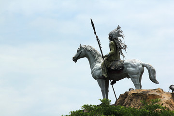 Statue of tribal Indians riding horses.