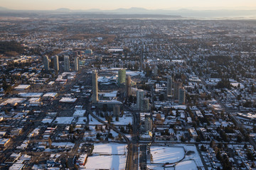 Aerial view of Surrey Central during a vibrant sunset after a snow fall. Taken in Vancouver, British Columbia, Canada.