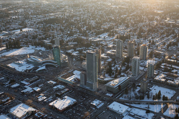 Vancouver, British Columbia, Canada - February 22, 2018: Aerial view of Surrey Central Mall and Residential Buildings during a vibrant winter sunset.