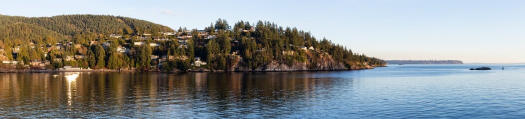 Beautiful panoramic view of the luxury homes with an Ocean View during a vibrant sunset. Taken in Horseshoe Bay, West Vancouver, British Columbia, Canada.