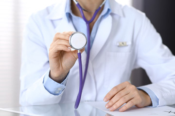 Doctor holds stethoscope head, closeup. Physician ready to examine and help patient. Medical help and insurance in health care, best treatment and medicine concept