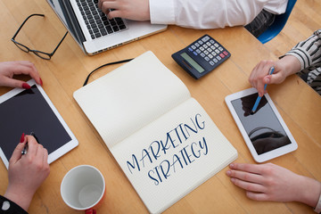 Marketing Strategy message in note book on office desk