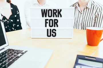 Work for us message on light box in office