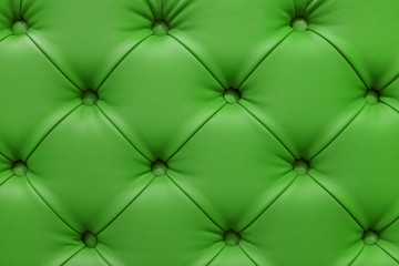 Green leather sofa stitched buttons.