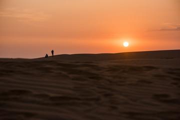 Sun setting below horizon in Mu Ne sand dune in Vietnam
