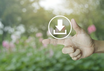 Download icon on finger over blur pink flower and tree, Business internet concept
