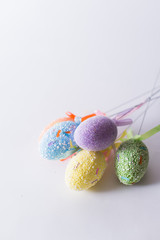 Easter eggs on a stick on a white background