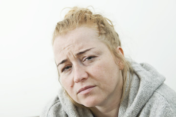 Young woman suffering from headache at home, closeup