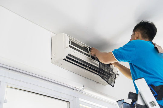 Unknown technician repairing an air conditioner