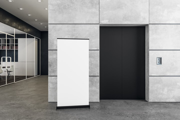 Contemporary office with elevator and poster
