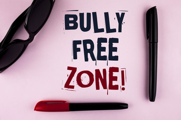 Text sign showing Bully Free Zone Motivational Call. Conceptual photo creating abuse free school college life written on plain background Markers and Sun Glasses next to it.
