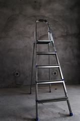 ladder of a stepladder in a gray room