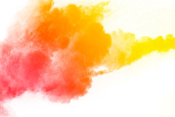 orange color powder explosion cloud isolated on white background.
