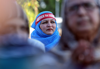 A woman wearing a headband attends a protest against the rape of an eight-year-old girl in Kathua, near Jammu, and a teenager in Unnao, Uttar Pradesh state, in Chennai