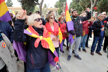 People chant as they commemorate the 87th anniversary of the declaration of the Second Spanish Republic at the General Cemetery in Valencia