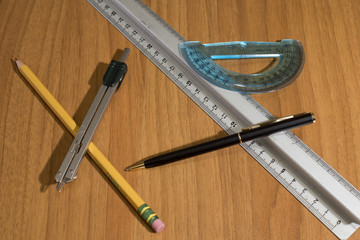 Chancellery items, compass, pencil, ruler on a table