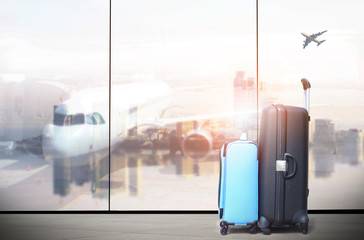 traveler suitcases in airport terminal waiting area,  interior with large windows, focus on suitcases ,summer vacation concept,Suitcases in airport departure lounge, airplane in background,