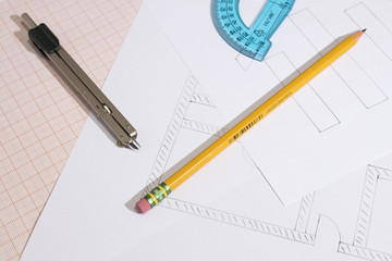 Projects and graph paper with pencil and compass composition