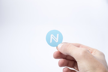 Cryptocurrency hand is holding a namecoin composition