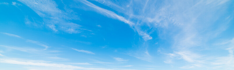 Small clouds in the blue sky in springtime