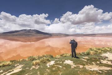 Photographer on the Colorada lagoon, Altiplano, Bolivia