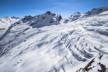 Snow-covered glacier in a Mountains of Saas-Fee in Switzerland