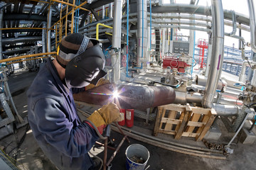 Welding works at installation of new pipeline