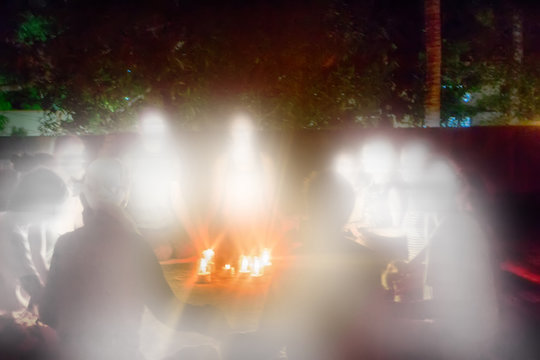 group of believers gathered nights and formed circle around candles