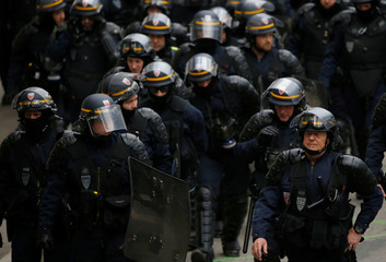 French CRS riot police gather during a protest demonstration in Nantes