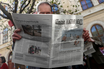 A man reads a samizdat edition of the newspaper Magyar Nemzet in Budapest