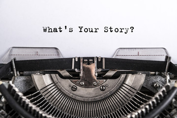 what's your story? The text is typed on paper with an old typewriter, a vintage inscription, a story of life.