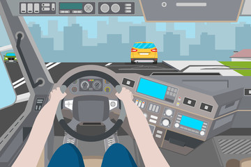 The driver is traveling in the city. City view from the cab of the truck. Vector illustration