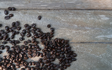 Flat lay coffee beans on vintage wooden table top